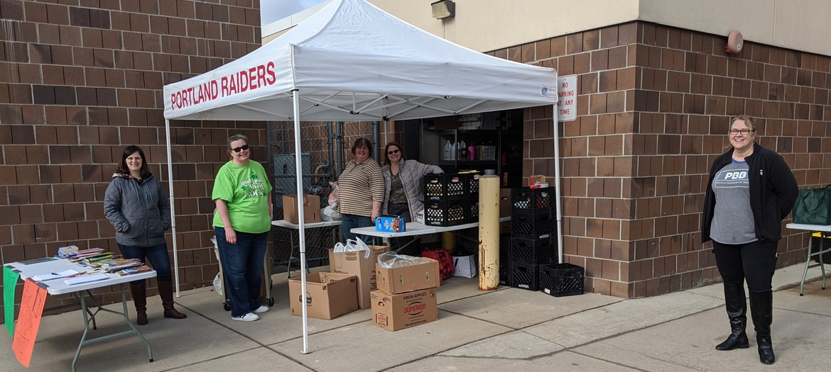 Handing out food and books